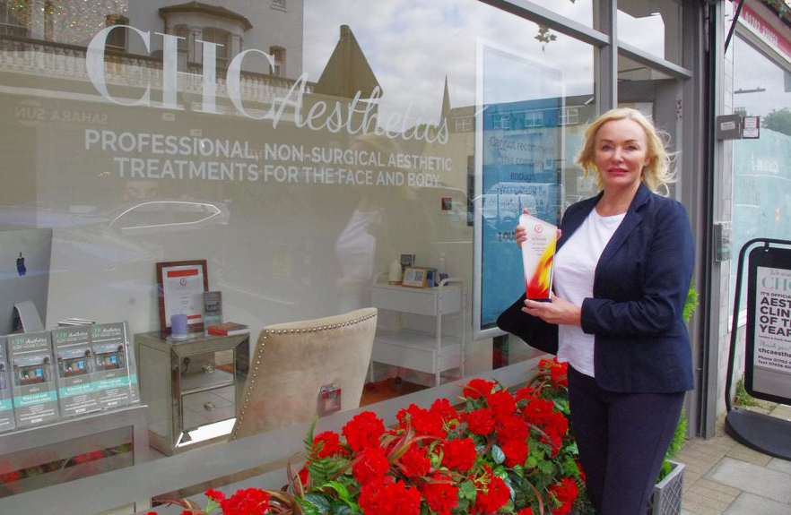Clinic founder Penny Hawker with Aesthetics Clinic Of The Year award